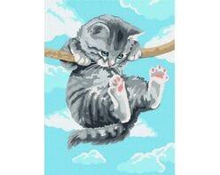 Kotek na gałęzi