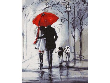 Spacer pod czerwoną parasolką
