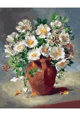 Białe kwiaty w dzbanku