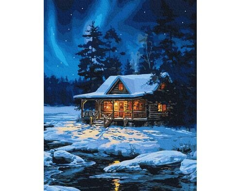 Leśny domek zimą